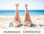 girls in the beach enjoying the ...   Shutterstock . vector #1304561410