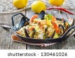tasty spanish paella with... | Shutterstock . vector #130461026
