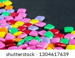 lies a lot of rainbow colored... | Shutterstock . vector #1304617639