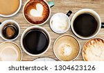 assorted coffee cups on a...   Shutterstock . vector #1304623126