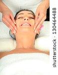young woman receiving massage   ... | Shutterstock . vector #130464488