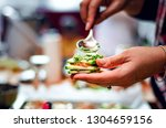 Stock photo closeup of female hands making raw lasagna with zucchini tomatoes nuts and garlic at the food 1304659156
