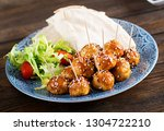 meatballs in sweet and sour... | Shutterstock . vector #1304722210