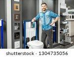portrait of a man as a seller... | Shutterstock . vector #1304735056