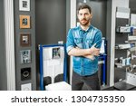 portrait of a man as a seller... | Shutterstock . vector #1304735350