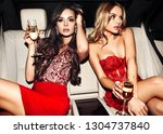 sexy woman couple in the car.... | Shutterstock . vector #1304737840