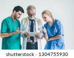 group of happy doctor surgeon... | Shutterstock . vector #1304755930