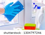 a hand in rubber glove washes a ... | Shutterstock . vector #1304797246
