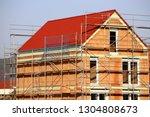 detached house under... | Shutterstock . vector #1304808673