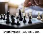 businessman's hand playing... | Shutterstock . vector #1304812186