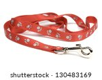 Stock photo red nylon dog lead or leash with paw print pattern isolated over white soft shadow under lead 130483169