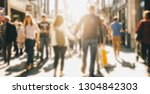 crowd of people in a shopping... | Shutterstock . vector #1304842303