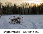 in winter  a horse rake stands... | Shutterstock . vector #1304845453