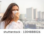 Small photo of Bangkok Thailand encountered heavy dust pollution problems.Asian women wearing air-protective masks with dust 2.5 Particulate Matte in the air are polluting the capital of Bangkok.