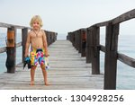 happy little child with... | Shutterstock . vector #1304928256