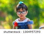 indian little girl child... | Shutterstock . vector #1304957293