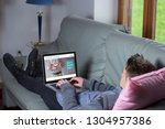 young man lying on the sofa... | Shutterstock . vector #1304957386