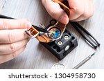 watch repairer workshop  ... | Shutterstock . vector #1304958730