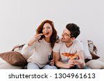 man with slice of pizza looking ... | Shutterstock . vector #1304961613