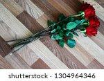 top view of dark red roses...   Shutterstock . vector #1304964346