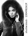 girl posing hooded fur coat.... | Shutterstock . vector #1304982619