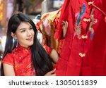 asian tourist girl wearing red... | Shutterstock . vector #1305011839