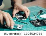 electronics repair service.... | Shutterstock . vector #1305024796