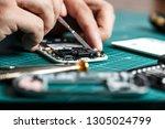 electronics repair service.... | Shutterstock . vector #1305024799