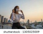 asian businesswomen wearing...   Shutterstock . vector #1305025009