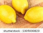 fresh lemon on table.... | Shutterstock . vector #1305030823