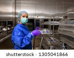 a young woman works in a... | Shutterstock . vector #1305041866