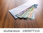euro banknotes in white... | Shutterstock . vector #1305077113