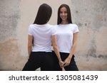 attractive twin girls in white...   Shutterstock . vector #1305081439
