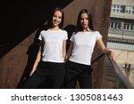 attractive twin girls in white...   Shutterstock . vector #1305081463