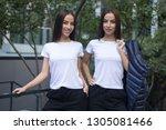 attractive twin girls in white...   Shutterstock . vector #1305081466