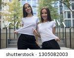 attractive twin girls in white...   Shutterstock . vector #1305082003