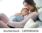 young mother  holding her sick... | Shutterstock . vector #1305083656
