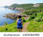 a young female hiker standing... | Shutterstock . vector #1305086980