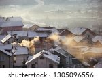 smoking chimneys at roofs with... | Shutterstock . vector #1305096556