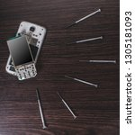 disassembled mobile phone and... | Shutterstock . vector #1305181093