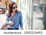 woman in shopping. happy woman... | Shutterstock . vector #1305213493