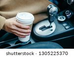 woman hand taking cup with...   Shutterstock . vector #1305225370