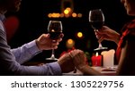 couple tasting red wine in high ... | Shutterstock . vector #1305229756