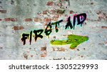 wall graffiti to first aid   Shutterstock . vector #1305229993