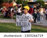 Small photo of Lima, Lima / Peru - February 2 2019: Adorable cute boy holding sign 'mi futuro esta en Venezuela' at protest against Nicolas Maduro
