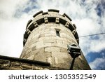 from below view of old stone... | Shutterstock . vector #1305352549