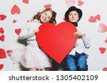 happy pre teen boy and girl... | Shutterstock . vector #1305402109