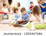 group of kids playing musical... | Shutterstock . vector #1305467686