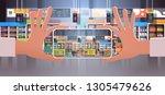 human hand holding smartphone... | Shutterstock .eps vector #1305479626