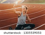 a young beautiful woman making... | Shutterstock . vector #1305539053